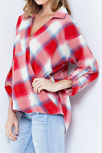 A plaid print textured rayon wrap v-neck wrap shirt featuring roll-up sleeves.