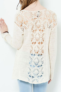 A long sleeve sweater top with see-through patterned on yoke and back