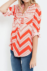 An abstract chevron print rayon china collar shirt with roll up sleeves