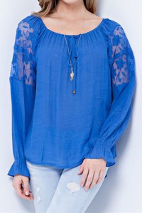 Solid gauze rayon peasant top with lace on sleeve. Elasticized cuff and neckline