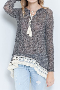 A two toned cut&sew sweater hooded top featuring crochet lace and tassel. High-l