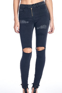 Dark charcoal skinny jean with raw cut hem with side zippers. Thigh area accente
